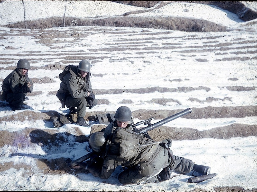 firing recoiless rifle in snowy rice paddy.jpg